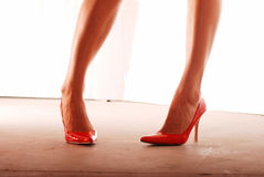 Red Pumps. Sexy legs in red patent leather pumps Stock Photo