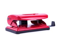 Red punch on white background. Bright hole punch isolate. Red stationery Stock Photo