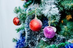 Red and purple balls and white and blue garland on a Christmas tree. Close up royalty free stock photos