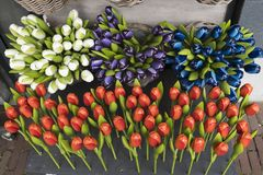 Various wooden and plastic tulips as Dutch souvenir royalty free stock image