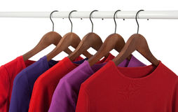 Red and purple casual shirts on hangers Royalty Free Stock Photos