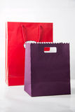 Red  and purple color paper bags isolated on white. Stock Photos