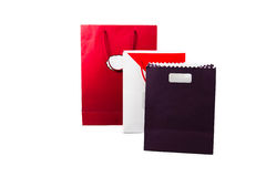 Red  and purple color paper bags isolated on white. Royalty Free Stock Image