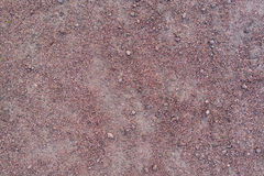 Red purple granite gravel texture. Shot directly from above stock image