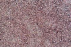 Red purple granite gravel texture Stock Image