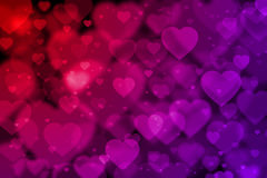 Red and purple hearts background with bokeh effect Stock Images