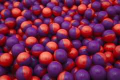 Red & purple paintballs Stock Photos