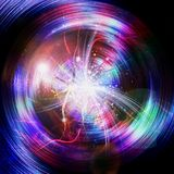 Abstract rotating background with rainbow rays and glowing light in the center. Red, purple, pink, green and blue spectral rays and light flashes. 3d Royalty Free Stock Images