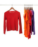 Red and purple shirts on wooden hangers Royalty Free Stock Images