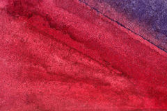 Red purple watercolor background wet. Washy watercolor background in blue and red Stock Images