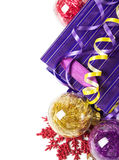 Red, purple and yellow xmas baubles Royalty Free Stock Photo