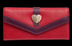 Red purse on a black background. Photos in the studio Stock Photos