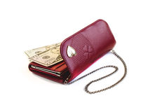 Red purse with chain. And dollars on a white background Royalty Free Stock Images