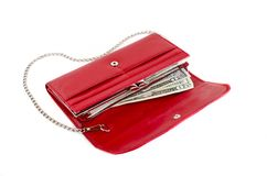 Red purse with chain. And dollars on a white background Royalty Free Stock Photos