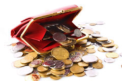Red purse and coins. Details of a red coin purse with a pile of coins spilling from it.  (Ukrainian coins Stock Photo