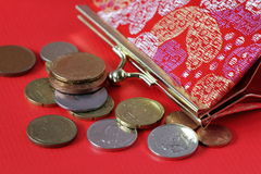 Red purse with coins Stock Photo
