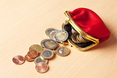 Red purse filled with euro coins Stock Image