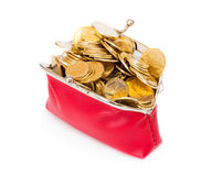 Red purse full of gold coins on a white Stock Photo