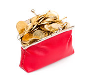 Red purse full of gold coins on a white Royalty Free Stock Image