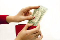 Red purse in hands with dollar Stock Images