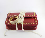 Red purse and pearl Stock Images