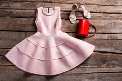 Red purse with salmon dress. Royalty Free Stock Images