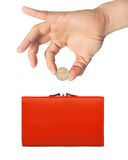 Red purse (wallet) and hand with coin isolated on white Stock Image