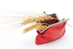 Red purse with wheat ears Stock Photo