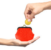 Red purse in woman hand and man hand with coin isolated on white Stock Photo