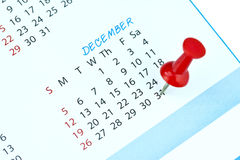 A red push pin. On the 31th december of a calendar Royalty Free Stock Photo