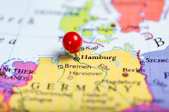 Red push pin on map of Germany. Map of Europe with a round red push pin placed on the city of Hamburg royalty free stock photography