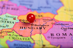 Red push pin on map of Hungary. Map of Europe with a round red push pin placed on the city of Budapest royalty free stock photos