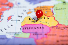 Red push pin on map of Latvia Stock Images