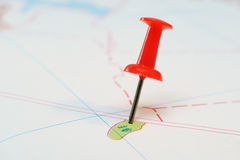 Red push pin on the map. Mark on the map as a red carnation stationery Royalty Free Stock Image