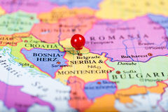 Red push pin on map of Serbia Royalty Free Stock Images