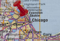 Red push pin pointing on chicago Stock Images