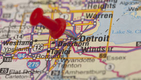 Red push pin pointing on detroit Stock Photography