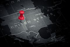 Red push pin on United States of america map Stock Photos
