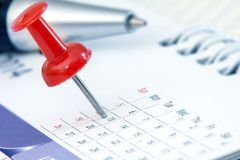 Red pushpin on calendar page for remind and marked important eve. Nts royalty free stock photography