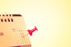 Red pushpin on calendar page for remind and marked important eve Royalty Free Stock Image