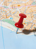 Red pushpin on a map Royalty Free Stock Image