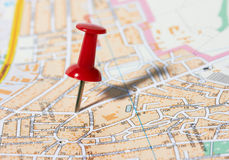 Red pushpin on a map. Red pushpin on a city map Stock Image