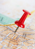 Red pushpin on a map. Red pushpin on a city map Royalty Free Stock Photos