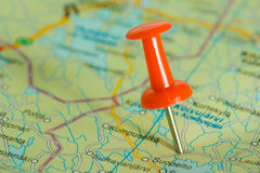 Red pushpin in a map Stock Photography