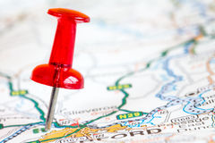 Red pushpin on a tourist map Stock Photography