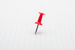 Red pushpin on white paper Royalty Free Stock Photography