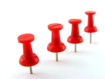 Red pushpins. A close up. It is isolated on a white background Royalty Free Stock Photo