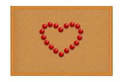 Red pushpins in a shape of a heart Royalty Free Stock Images