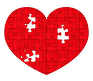 Red puzzle heart Stock Photos