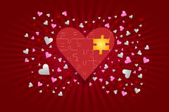 The red puzzle heart with golden component Stock Image
